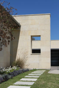 Shell Limestone wall cladding on the exterior of a home.