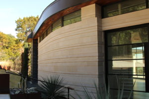 custom cut buff lueders contemporary stone home austin tx